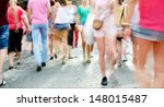 Motion blurred shoppers. Long time daytime blurred shot. - stock photo