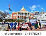 BOSTON - APRIL 6: Protestors at Massachusetts State House April 6, 2012 in Boston, MA. The building was completed in 1798. - stock photo