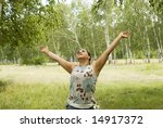 pretty relaxing woman in summer forest - stock photo