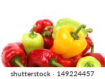 Multi-colored peppers on a white background. - stock photo