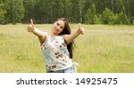 pretty woman showing OK sign - stock photo