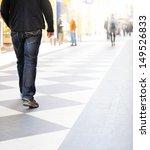Man walking on shopping street, intentional high key - stock photo
