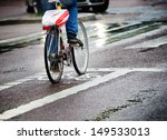 Bicycle in bike lane, after rains - stock photo