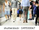 Subway passengers walking on platform - stock photo