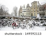 Bicycles in the snow in Amsterdam the Netherlands - stock photo