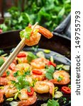 Fried shrimp with fresh herbs - stock photo