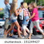 Zoom blurred image of pedestrian crowd - stock photo