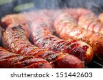 Closeup of sausage on the grill - stock photo