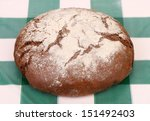 Traditional bread on check tablecloth - stock photo