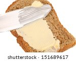 Smear butter on bread the knife. - stock photo