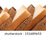 Slices of brown and white bread. - stock photo