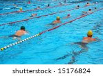 Swimming pool with water, lines and swimmers - stock photo