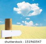 Empty wooden sign in desert - stock photo