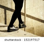 Taking the step - stock photo
