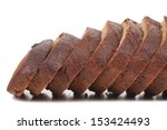 Brown bread slices. Close uop. Isolated on a white background. - stock photo