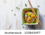 Chinese soup with shrimp and rice noodles - stock photo