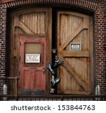 Zombie's tearing there way out of a grunge building. Creepy Halloween advertisement with room for text or copy space.  - stock photo