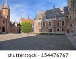 House with vines and old square in Bruges, Belgium  - stock photo