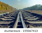 crossing of two railroad to horizon - stock photo