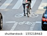 Bicyclist waiting for green - stock photo