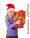 Smiling little girl in Santa's hat with red gift box, isolated on white - stock photo