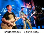 Band performs on stage, rock music concert - stock photo