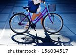 Woman walking with bike in evening - stock photo