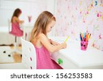 Adorable little girl in her room drawing - stock photo