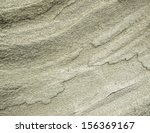 Close-up of an eroded and weathered rock. Abstract stone background - stock photo