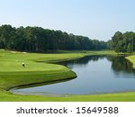 A lone golfer on this beautiful Myrtle Beach, South Carolina golf course. - stock photo