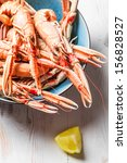 Freshly cooked scampi in a blue bowl with lemon - stock photo