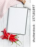 top view of recipe book with chili peppers - stock photo