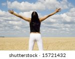 a young woman relaxing over sky background - stock photo