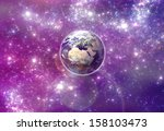 Earth and purple galaxy  Elements of this image furnished by NASA - stock photo