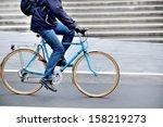 Man on bike in profile - stock photo