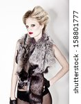 Attractive young blonde model in fur - stock photo