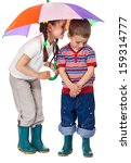 Two little children together under colorful umbrella - stock photo