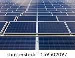 Photovoltaic Cells or Solar Panels in symmetric order - stock photo