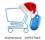 Christmas online shopping concept. Santa hat sitting on a shopping cart formed by a mouse cable. - stock photo