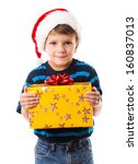 Cunning little boy in Santa's hat with yellow gift box, isolated on white - stock photo