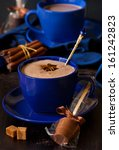 Cup of sweet hot chocolate on a dark background close up. - stock photo