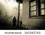 Horror scene of a female ghost - stock photo