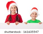 Christmas kids standing with empty horizontal banner in hands, isolated on white - stock photo