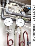 Closeup of a counters of a heating pipes system - stock photo