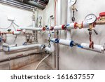 Heating pipes system in a basement of a house - stock photo