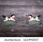 Christmas decorative ornament - Two wooden horses on wooden background - stock photo
