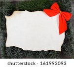 Christmas decoration and vintage paper on wooden background - stock photo