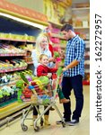 family shopping in grocery supermarket - stock photo
