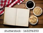 top view of cookbook with various soy products - stock photo
