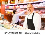 People at work in a grocery store - stock photo